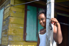 Native Nicaraguan girl smiling  clapboard house Big Corn Island Royalty Free Stock Images