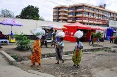 Native people made affairs. ARUSHA, TANZANIA - NOVEMBER 25: Native people made affairs near main road on November 25, 2011 in Arusha, Tanzania. Arusha is a city Stock Photo