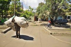 Native people made affairs. ARUSHA, TANZANIA - NOVEMBER 25: Native people made affairs near main road on November 25, 2011 in Arusha, Tanzania. Arusha is a city royalty free stock images