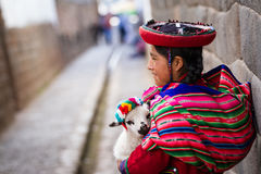 Native Peruvian holding a baby lamb Stock Images