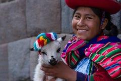 Native Peruvian holding a baby lamb Stock Photography