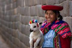 Native Peruvian holding a baby lamb Stock Photo