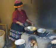 Native Peruvian woman preparing Cachangas aka fried bread on a p Stock Photography