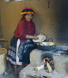Native Peruvian woman preparing Cachangas aka fried bread Stock Photography