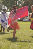 Native Powwow Editorial Image Series. SMITHS FALLS, ON, JUNE 10, 2017 EDITORIAL IMAGE SERIES OF NATIVES POWWOW CEREMONY with this image focused on a young native Royalty Free Stock Image