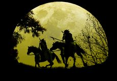 Native Riders Under Moonrise. American natives riding their horses, by fields,  under the rising Moon Royalty Free Stock Images
