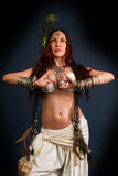 Native savage woman. Performance. Young attractive retro model in old-fashioned wild clothing dancing. Tribe. Tattoo. Native savage woman Royalty Free Stock Image