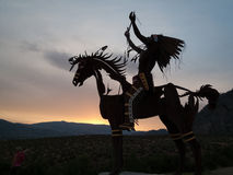 Native Sculpture at sunset Stock Photo