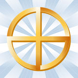 Native Spirituality Symbol. Golden Medicine Wheel symbol of Native Spirituality, on a sky blue rays background Stock Images