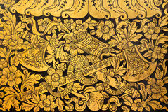 Native thai painting (Flower and vine bind twin axe) on wall Stock Photos