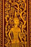 Native thai sculpture on wooden door Stock Photos