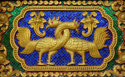 Native Thai style carving decorated in temple. Sculptures in the temple. Native Thai style carving decorated in temple Royalty Free Stock Image