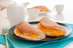 Native Thai style of pancakes served with tea. Stock Photos