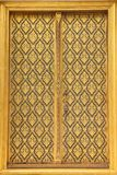 Native Thai style of pattern on door temple Royalty Free Stock Photo