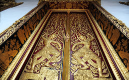 Native Thai style pattern on door temple Royalty Free Stock Photo