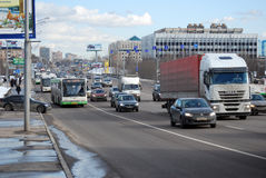 The Native of the Volga region bus moving on the allocated strip on Volokolamskoye Highway. Moscow Stock Photography