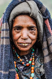 Native woman with headcloth in Nepal. Dolpo, Nepal - circa June 2012: Native woman with beads around her neck wears headcloth and blanket around her head has Stock Photography