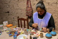 Native woman painting pottery. Peru Stock Photography