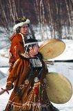 Natives. Of Russia play national tools and sing Stock Photography
