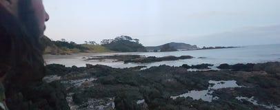 Natives enjoying nature. Private bay of island beach called elliots bay Stock Photography