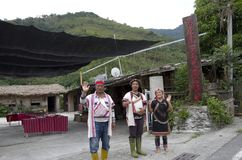 Natives in Taitung saying farewell to tourists. A family of natives saying goodbye to visiting guests after showing their culture and cuisines Stock Photography
