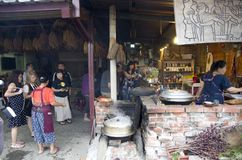 Tourists visiting natives in Taitung Taiwan. The natives were showing the tourists what they grew and how they cooked. Taitung Taiwan Stock Photo
