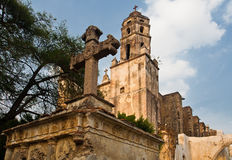 Natividad Church Tepoztlan. A cross and the two imposing towers of Natividad Church in Tepoztlan, Mexico royalty free stock images