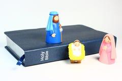 Natividade e Bíblia das crianças Imagens de Stock
