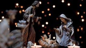 A natividade figura o comedoiro do Natal da cena com luzes vídeos de arquivo