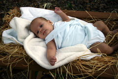 Nativity. Baby in manger in swaddling clothes Royalty Free Stock Images