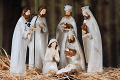 Nativity in a Barn. A nativity scene composed of Mary, 3 wise men, 2 Shepards and baby Jesus. All on a floor of straw in an old wood barn. Shallow depth of field royalty free stock photos