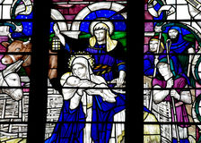 The Nativity (birth of Jesus) in stained glass Stock Images