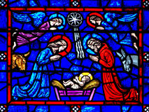 The nativity (birth of jesus) in stianed glass. A photo of The nativity (birth of jesus) in stianed glass royalty free stock images