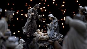 Nativity figures scene Christmas manger with lights