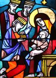 Nativity Scene, Adoration of the Magi. Stained glass window in Basilica of St. Vitus in Ellwangen, Germany Stock Photos