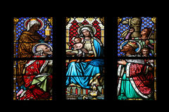 Nativity Scene, Adoration of the Magi. Stained glass window in parish church of Saint Mark in Zagreb, Croatia Stock Image