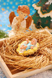 Nativity scene with baby jesus and angel Stock Photo