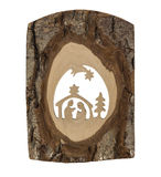 Nativity scene carved in a tree bark. Hand made wooden christmas decoration silhouette stock photography