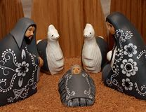 Nativity scene with characters dressed in black Royalty Free Stock Images