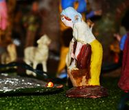 Nativity scene, Christmas and Italian traditions. Female statue walking and blurred background, detail from a nativity scene in north Italy Stock Photo