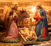Nativity scene with holy family in a manger Stock Photography
