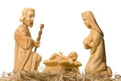 Nativity Scene isolated on white. Wooden figures of Mary and Joseph watching baby Jesus, isolated on white stock photos