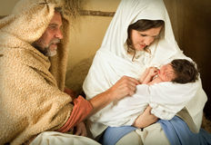 Nativity scene live. Living christmas nativity scene reenacted with a real 18 days old baby Royalty Free Stock Image
