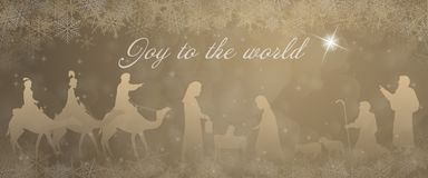 Christmas time - Nativity scene. Nativity scene with Mary, Joseph, baby Jesus, shepherds and three kings in Christmas landscape Stock Image