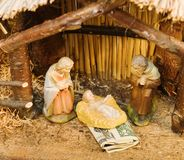 Nativity Scene with Money. Commercialism vs Christmas Mary Joseph Christ and Money Stock Photography