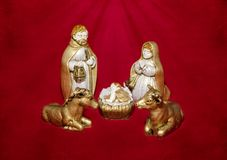 Nativity scene on red background stock photos