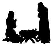Nativity Scene Silhouettes. Traditional religious Christian Christmas Nativity Scene of baby Jesus in the manger with Mary and Joseph in silhouette Stock Photos