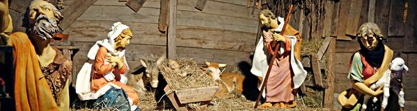 Nativity scene in the stable. Christmas scene manger with figures including Jesus Maria Giuseppe ox and donkey Stock Photo