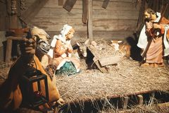 Nativity scene in the stable. Christmas scene manger with figures including Jesus Maria Giuseppe ox and donkey Royalty Free Stock Photos