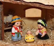 Nativity scene with statues of hand-decorated pottery Royalty Free Stock Image